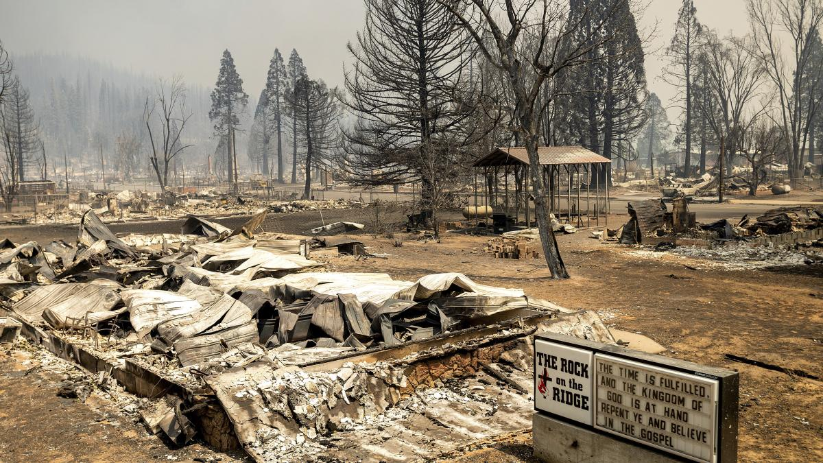 A church marquee stands among buildings destroyed by the Dixie Fire in the Sierra Nevada town of Greenville on Thursday.