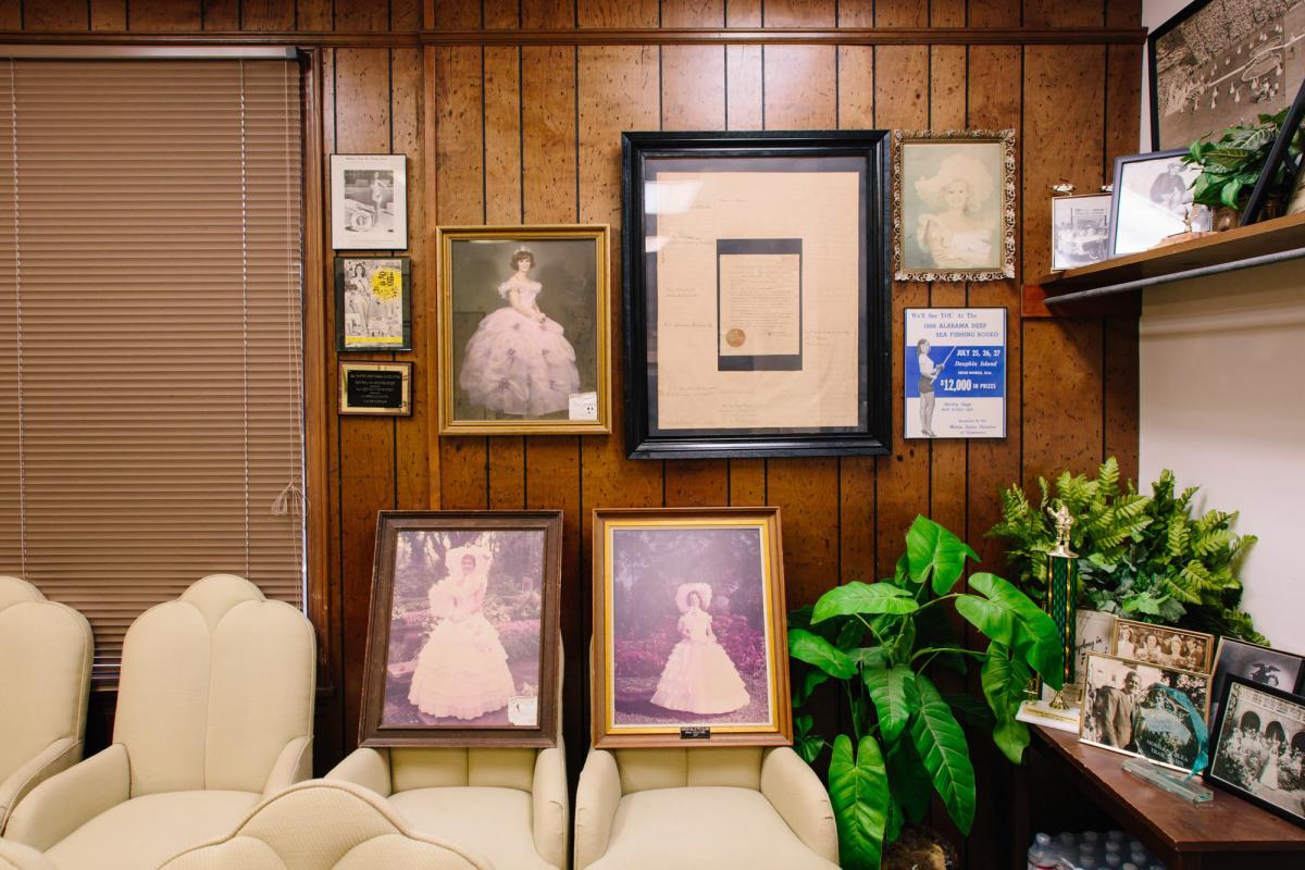 The Azalea Trail Maids' office in Mobile features vintage photos of past Trail Maids. The roots of the tradition started in 1929.