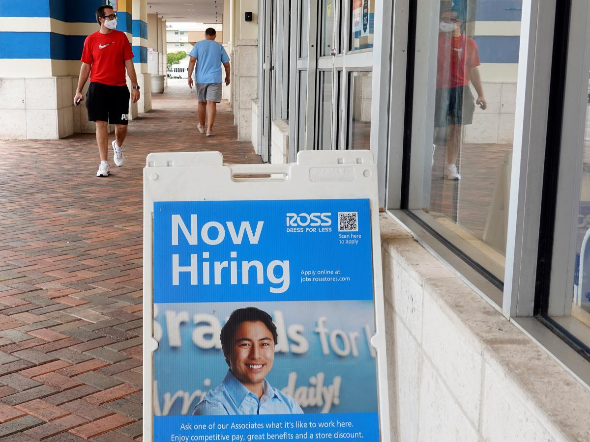 """A """"Now Hiring"""" sign is shown near the entrance to a Ross department store on Sept. 21, in Hallandale, Fla. Employers added far fewer jobs than expected in August as the Delat variant continues to spread."""