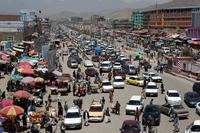 Before 2002, there were few cars in Kabul. Now traffic jams, like this one in western Kabul in 2013, are common.