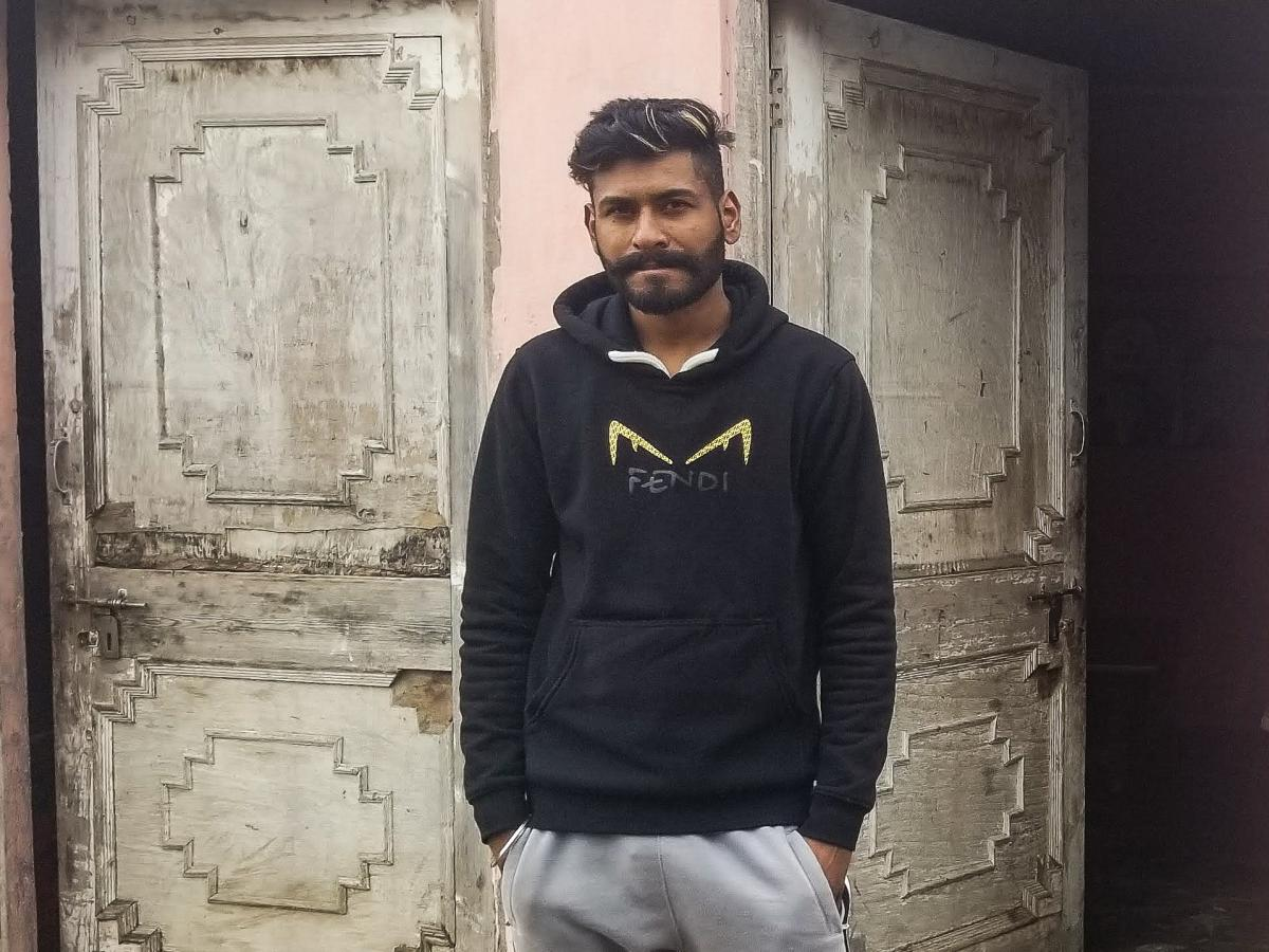 Sevak Singh, 26, in front of his family's home in rural Punjab. Singh planned to cross the U.S.-Mexico border illegally but was deported from Mexico in October. He admits that he and other Punjabi Sikh migrants rehearsed fake backstories about being perse