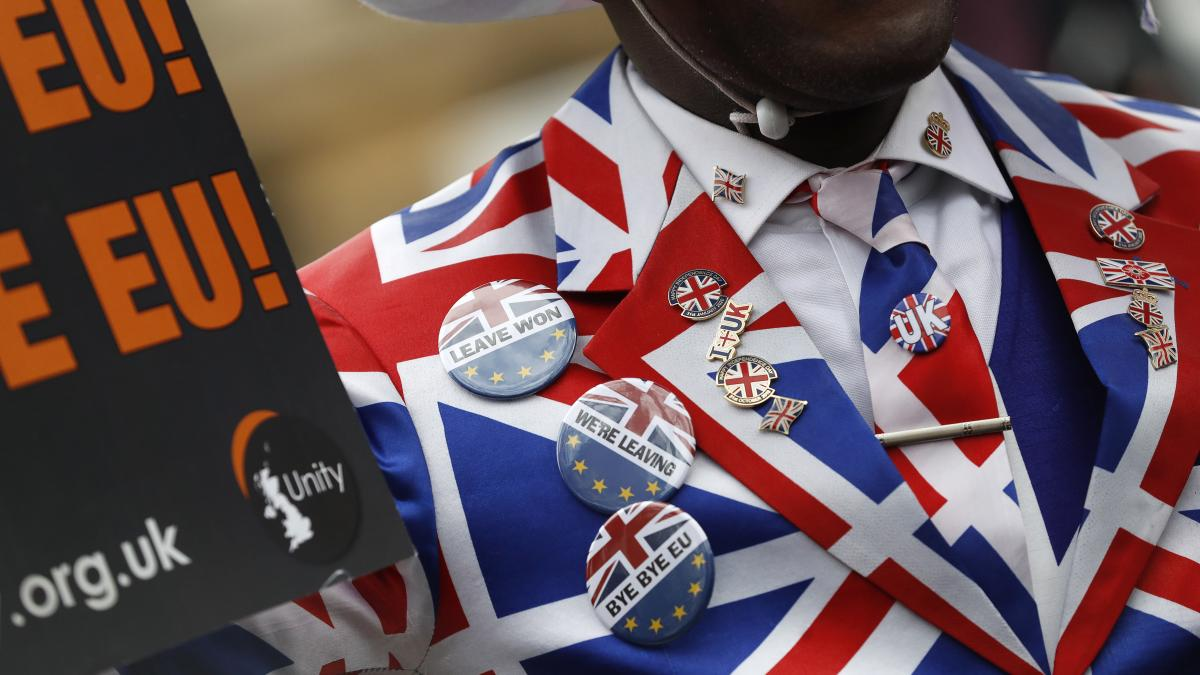 A Brexit supporter is decked out in London on Friday, hours before the U.K. was to leave the European Union. More than 3 1/2 years after the referendum that approved Brexit, Britain is parting ways with the 27 remaining members of the European bloc.