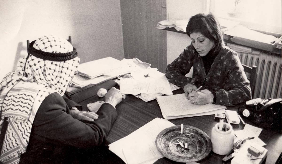 A younger Tsemel meeting a Palestinian client. She has represented Palestinian suspects in Israeli courts for nearly 50 years.