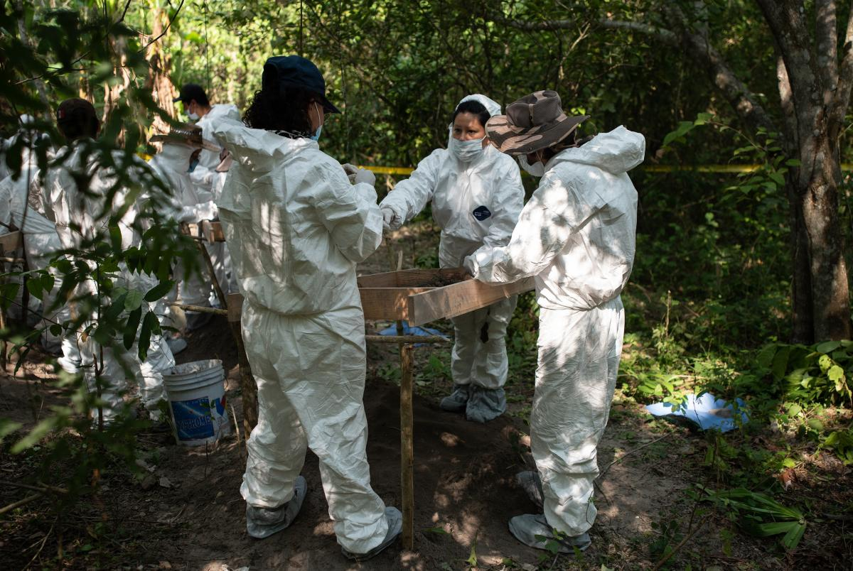 Relatives of missing persons and forensic experts work together at a location where human remains have been identified.