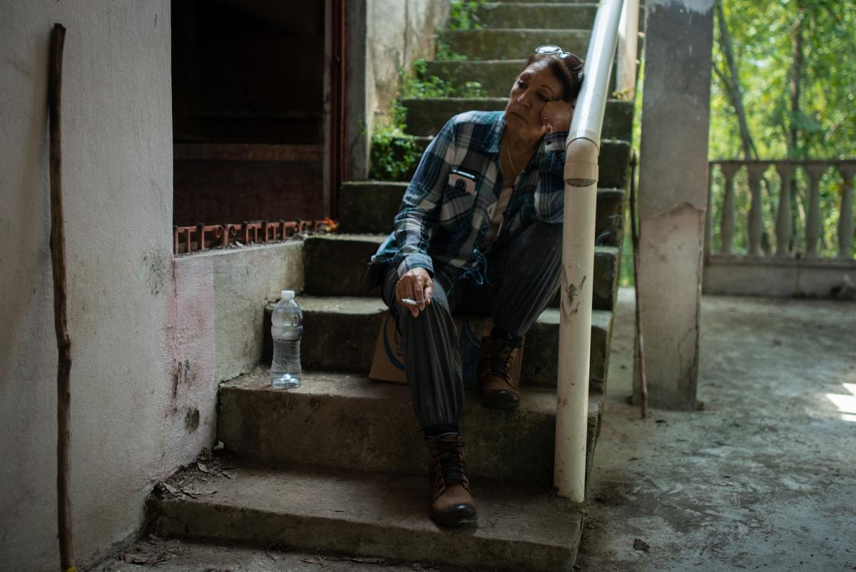 Teresa Figueroa, 66, from Baja California, Mexico, rests inside a house where human remains have been located during the fifth National Missing Persons Search Brigade outside Poza Rica in Veracruz, Mexico, on Feb. 20.