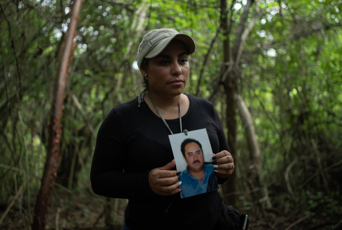 Yadira Gonzalez, 38, poses with a picture of her missing brother, Juan Gonzalez.