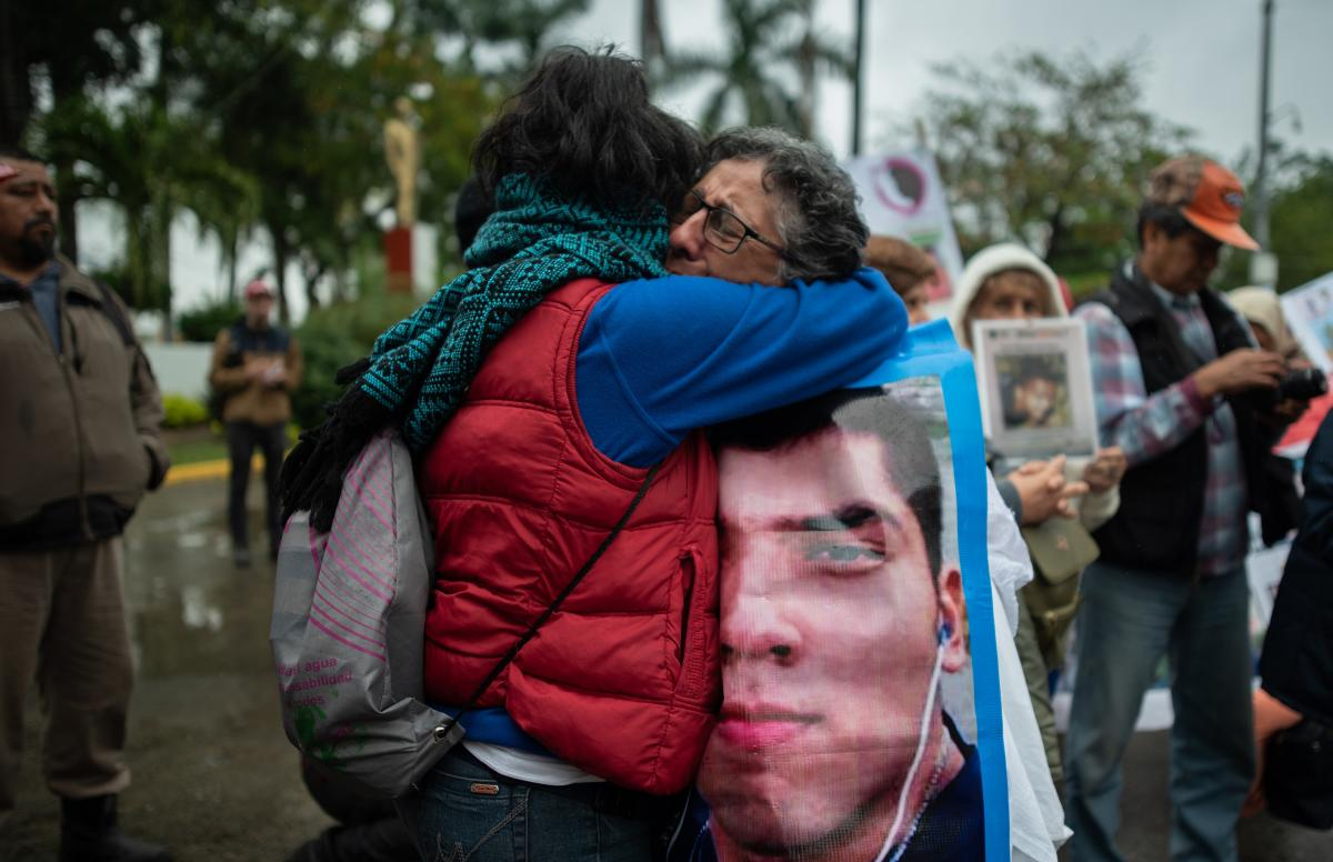Two women embrace and weep during a demonstration in Poza Rica on Feb. 21. Approximately 300 people participated in the fifth National Missing Persons Search Brigade in the city.