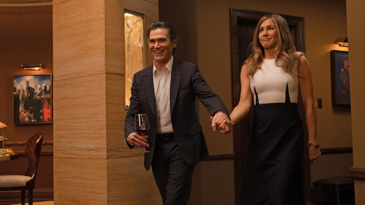Cory (Billy Crudup), Alex (Jennifer Aniston) and the interesting darts in Alex's dress all are hoping for a nice dinner.
