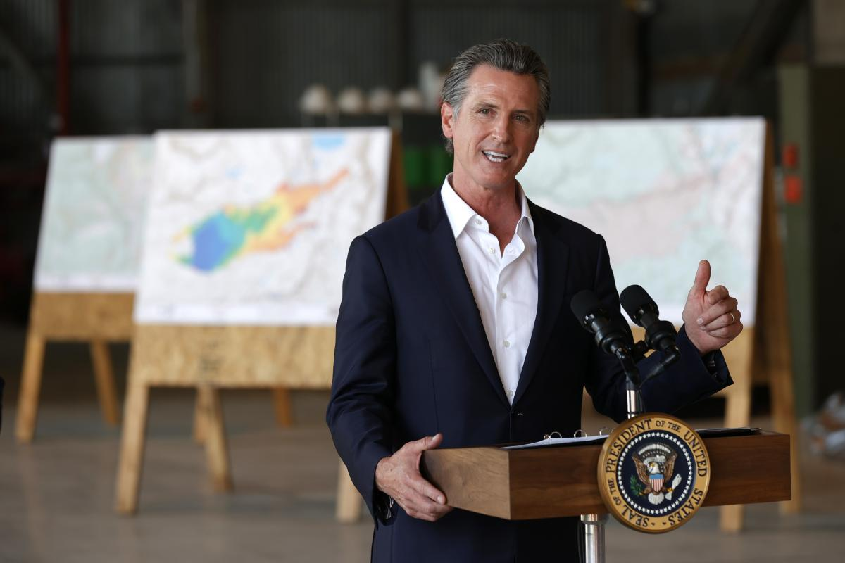 California Gov. Gavin Newsom delivers remarks after a helicopter tour of the Caldor Fire area with President Biden on Monday in Mather, Calif. Biden then went to the Los Angeles area to participate in a No on Recall campaign event with Newsom.