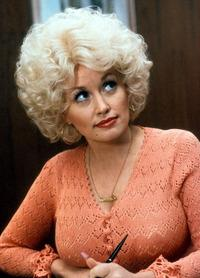 Dolly Parton in a scene from the film 9 to 5.