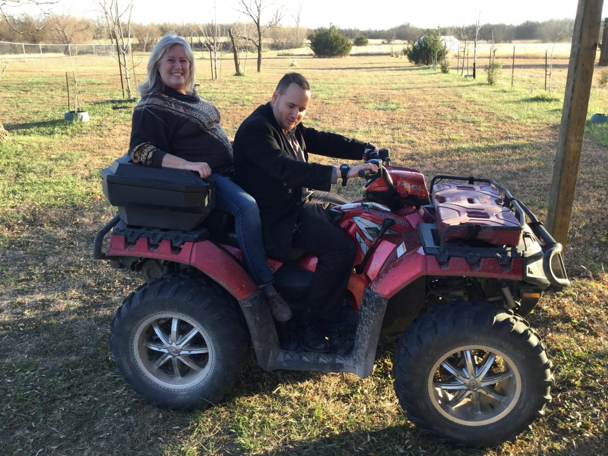 Lamo drives an ATV for the first time with Debbie Scroggin at a family friend's home.