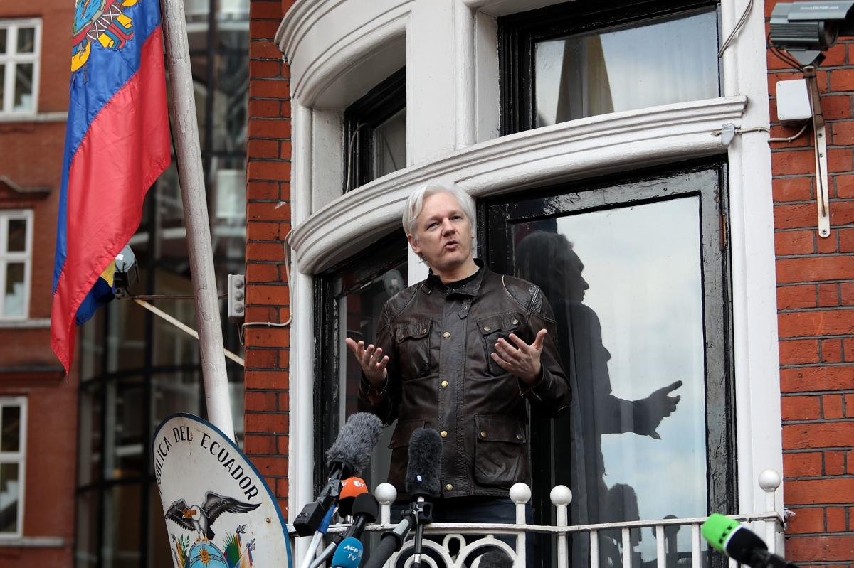 Julian Assange speaks to the media from the balcony of the Embassy Of Ecuador in London in 2017. The founder of the WikiLeaks website was forcibly removed from the embassy earlier this year and is fighting extradition to the U.S. to face charges related t