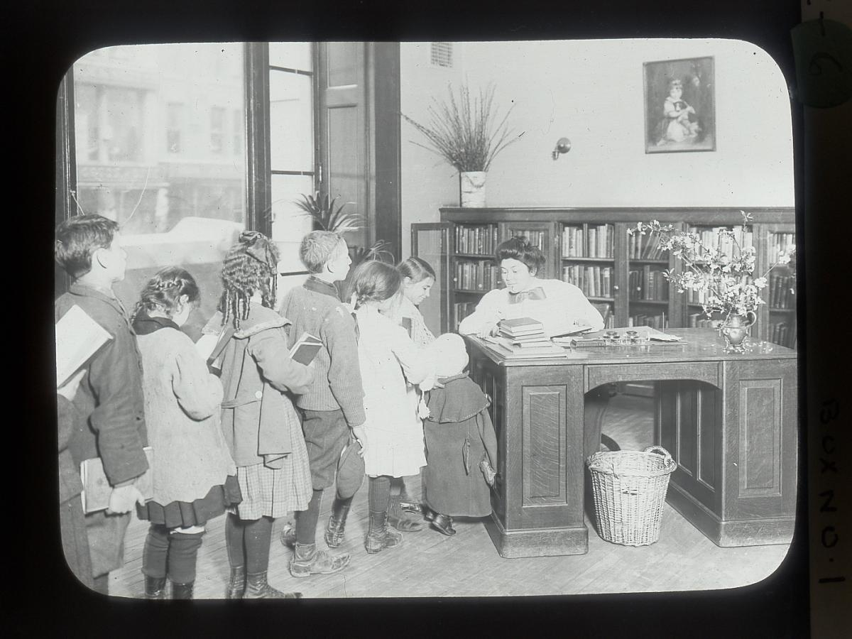 Children line up at the Chatham Square Library on Manhattan's Lower East Side in 1911.