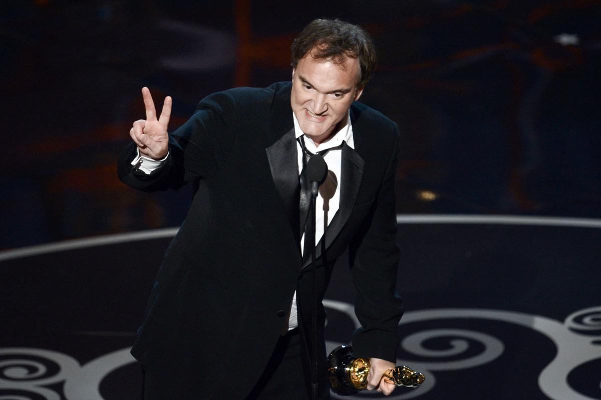 """Quentin Tarantino accepts the Oscar for best original screenplay for """"Django Unchained."""""""