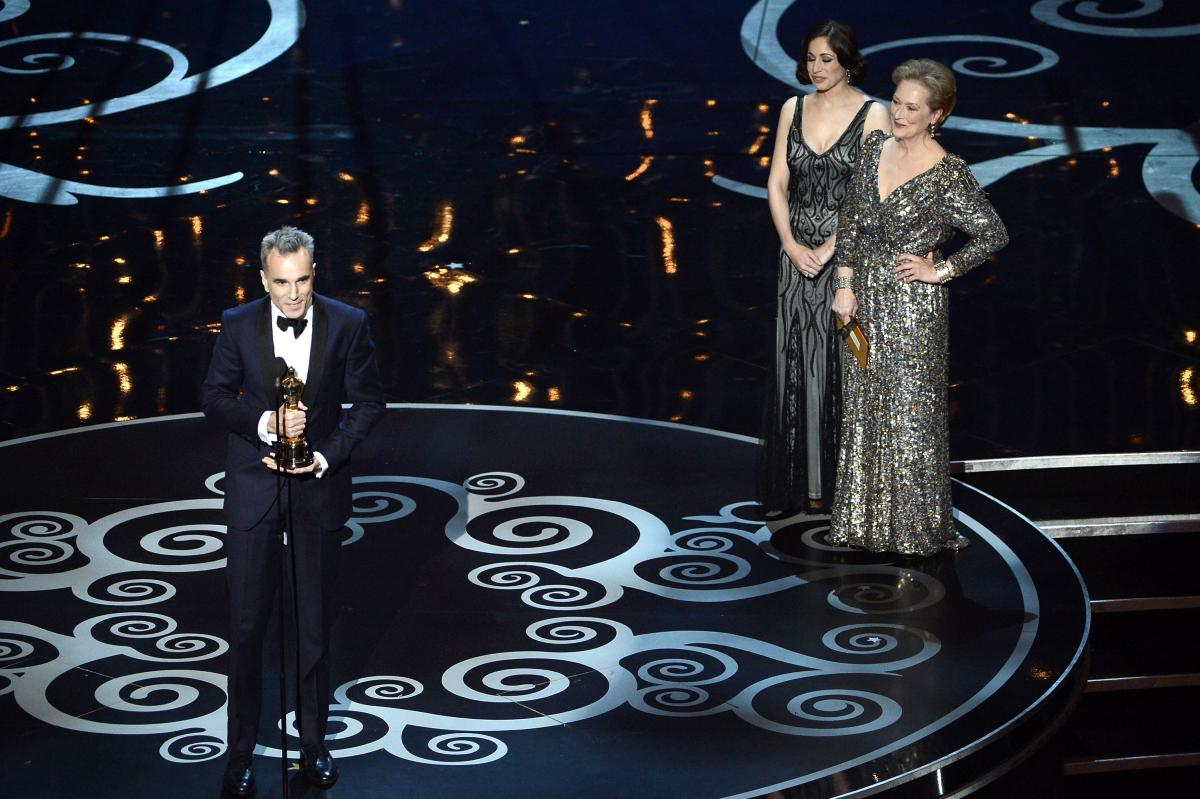 """Daniel Day-Lewis accepts the Oscar for best actor for his role in """"Lincoln."""""""