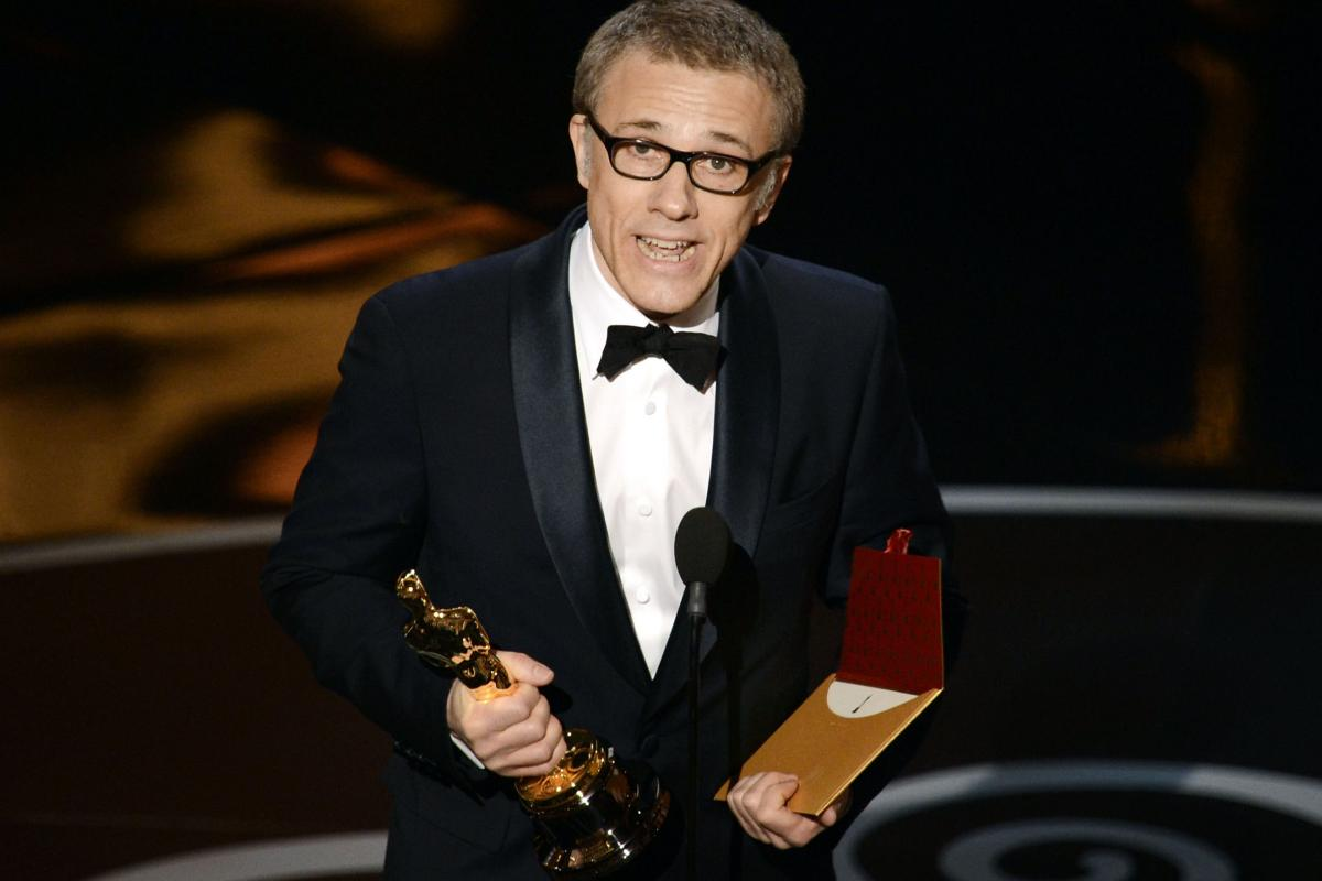 """Actor Christoph Waltz accepts the Oscar for best supporting actor for his role in """"Django Unchained."""""""