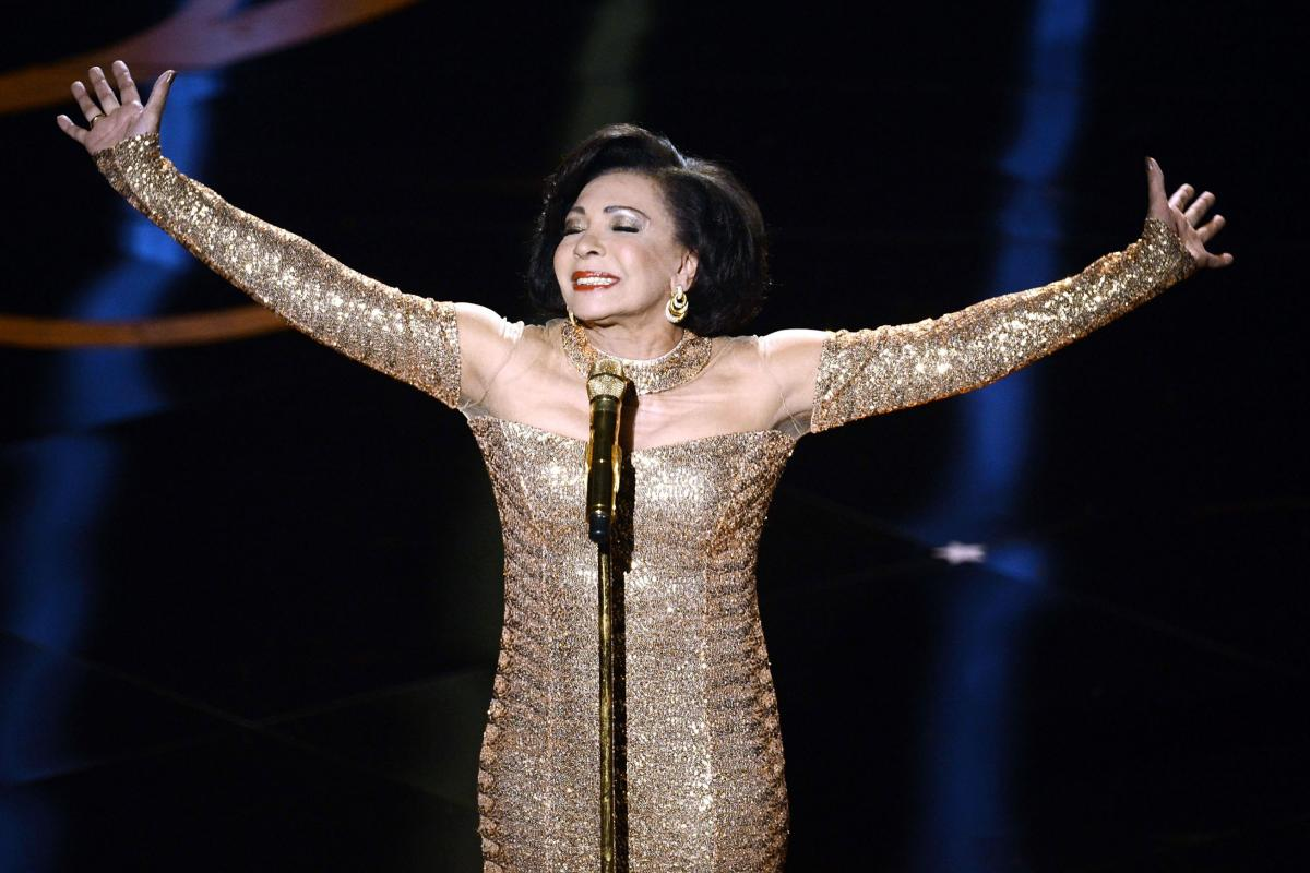 """The legendary Shirley Bassey makes an appearance to sing the theme song from the James Bond classic """"Goldfinger."""""""