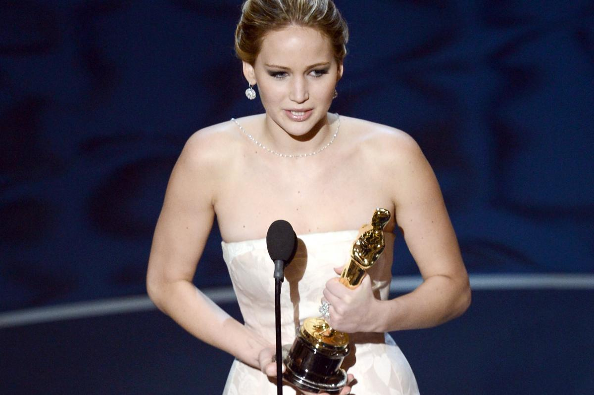 """Jennifer Lawrence accepts the Oscar for best actress for her performance in """"Silver Linings Playbook."""""""