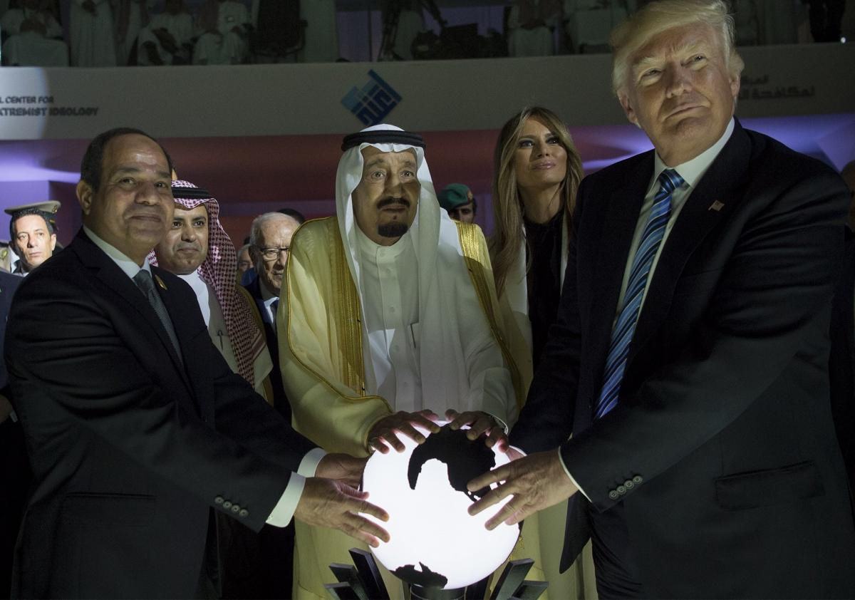 President Trump, Saudi Arabia's King Salman bin Abdulaziz al-Saud (center) and Egyptian President Abdel Fattah el-Sisi (left) place their hands on an illuminated globe as First Lady Melania Trump watches during the inauguration of the Global Center for Co