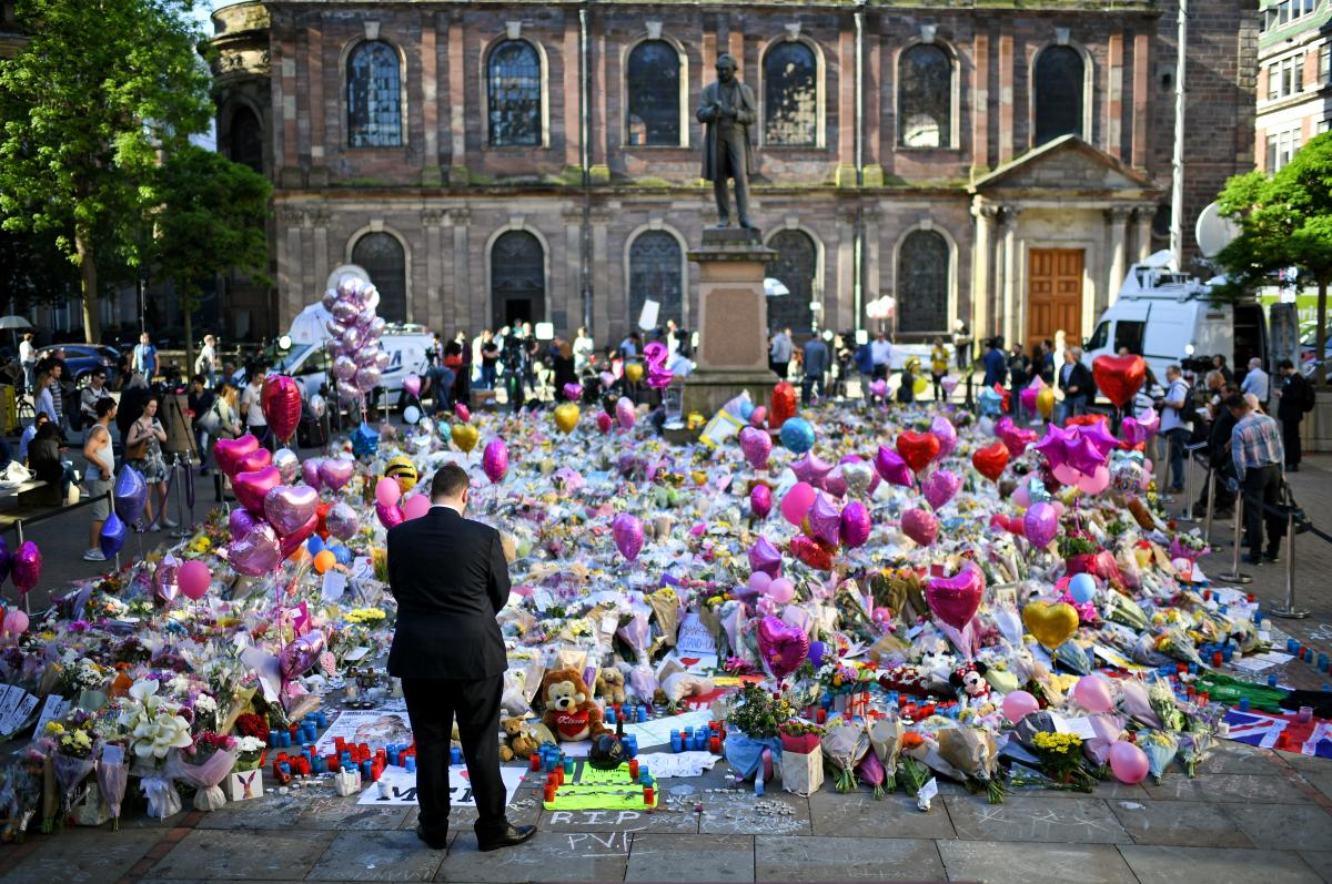 Flowers and tributes were left in Manchester's St. Ann's Square honoring the memories of those who died in May's terrorist attack at the Manchester Arena.