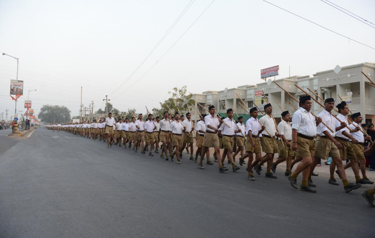 RSS volunteers participate in a parade on the outskirts of Ahmedabad in 2015.