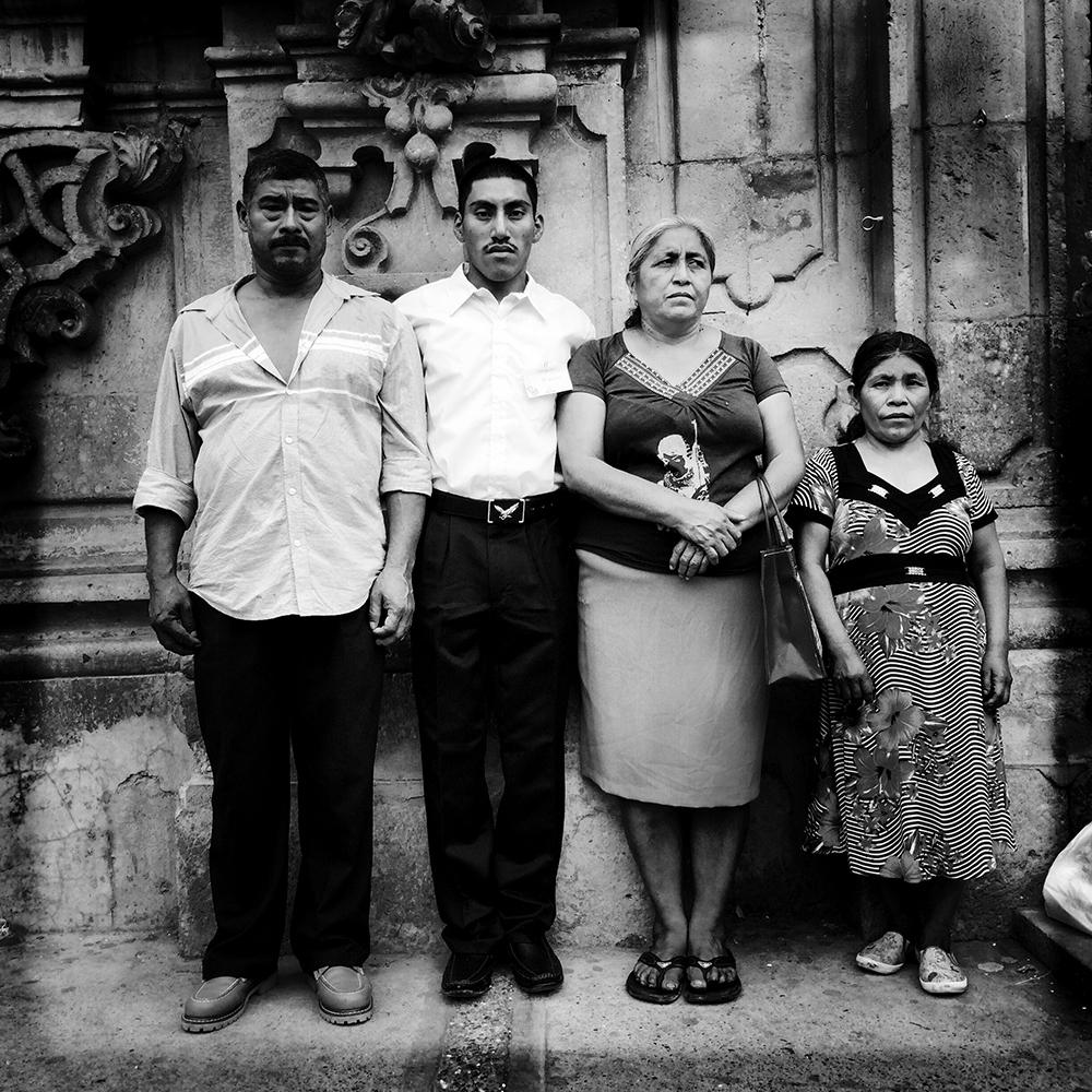 """""""Family Portrait After Church."""" Don Bernabe, left, and Dona Delfina, third from left, are the parents of missing Mexican student Adan Abrajan de la Cruz. They're posing with their godson, Marcos, and his mother, Dona Rosa."""