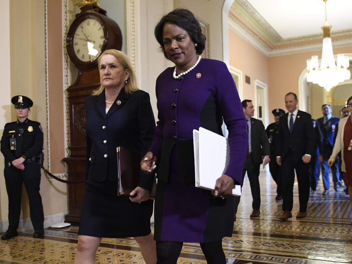 Impeachment managers Rep. Val Demings, D-Fla., center, and Rep. Sylvia Garcia, D-Texas, left, walk to the Senate trial of President Trump in February.