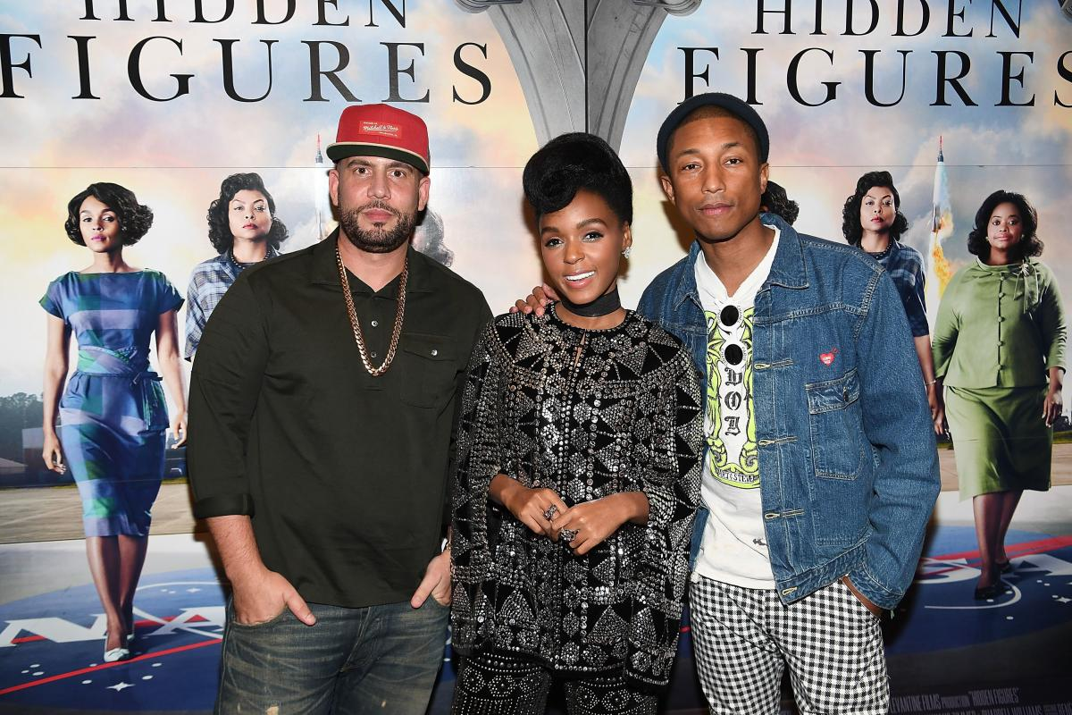 DJ Drama with Janelle Monae and Pharrell Williams in 2016.