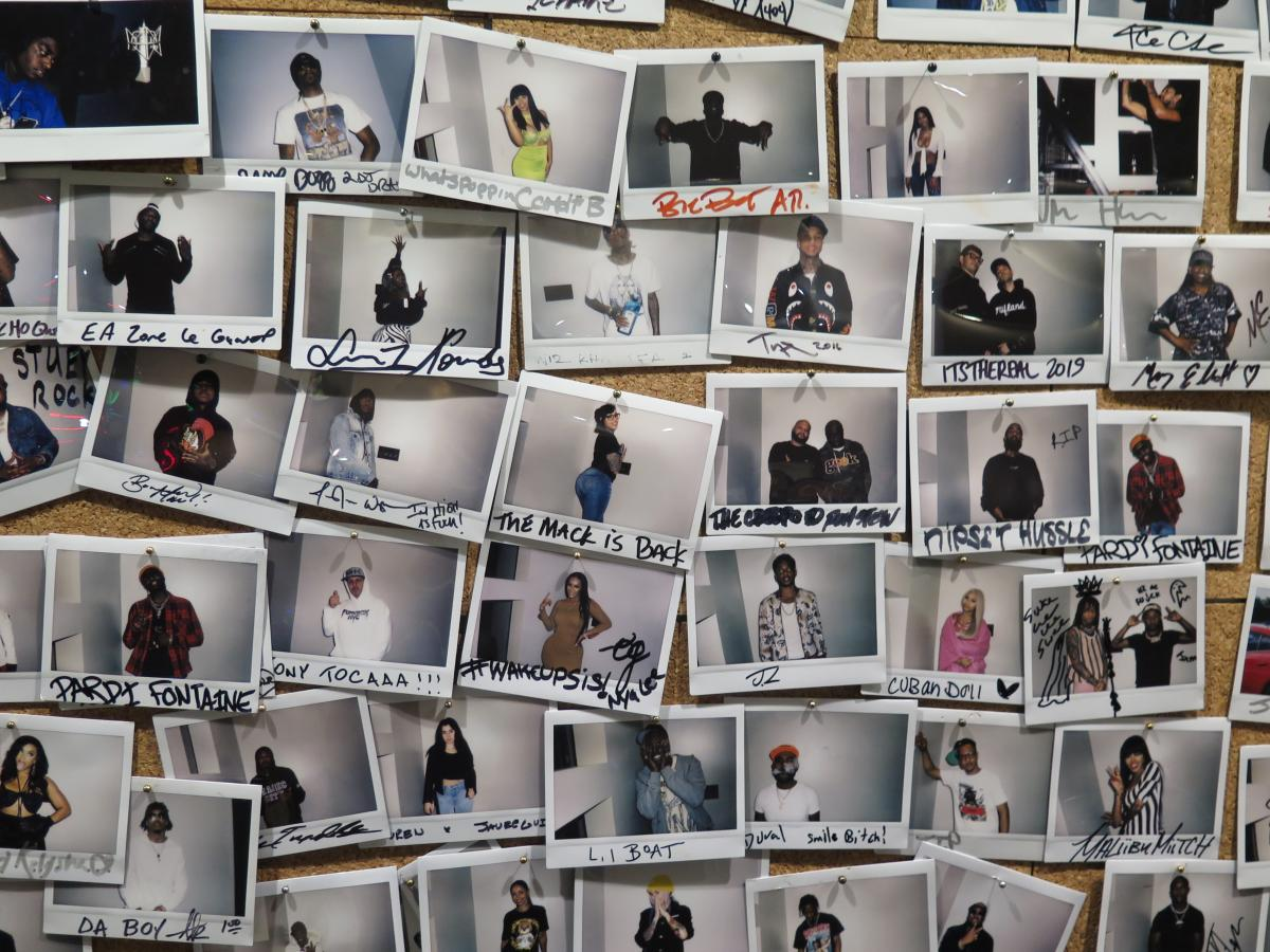 """Inside DJ Drama's Means St. Studio in Atlanta today, a """"wall of fame"""" contains snapshots of artists who have passed through."""