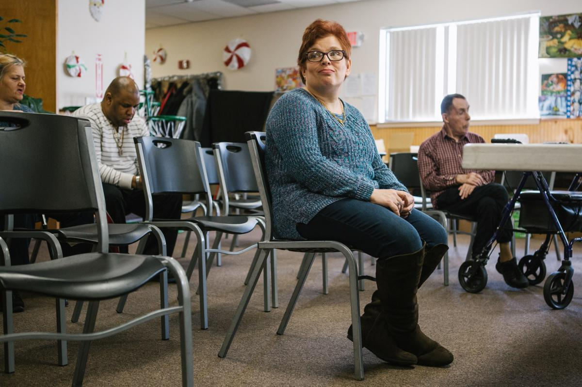 Pauline sits after practice for a Christmas show with fellow group members of a day program at the Arc Northeastern Pennsylvania. Pauline, who has intellectual disabilities, has been with the Arc program since 2014, after an emergency removal from her pre