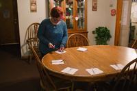 """Pauline helps set the table for dinner at her group home. """"I was scared the first day I went to the house,"""" she says, referring to the group home she currently lives in. """"I didn't know anyone."""" Since coming into the group home, Pauline says, she is happie"""