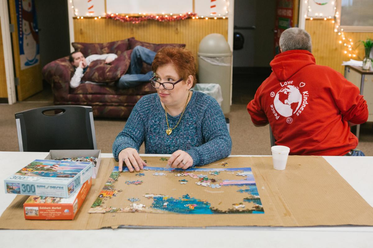 Pauline, 46, puts together a puzzle at her day program. Adults with intellectual disabilities are among groups with one of the highest rates of sexual assault in the United States, according to previously unpublished sex crime data from the Justice Depart