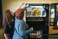 Erica Francis, a direct support professional, helps Pauline as they restock a vending machine at Arc of Northeastern Pennsylvania.