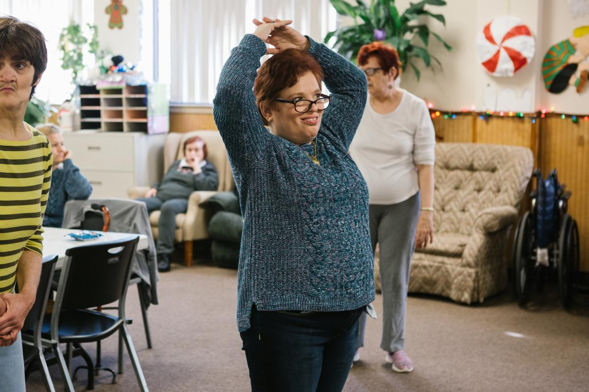 Pauline dances along to a video during a morning exercise routine at the Arc Northeastern Pennsylvania.