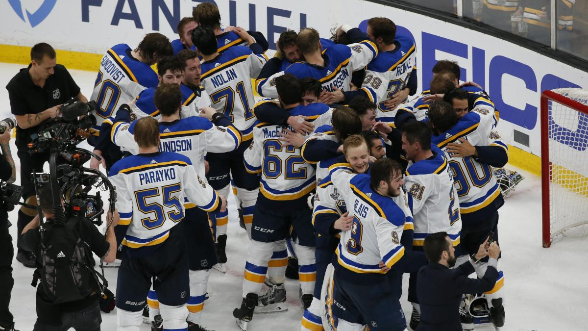 The St. Louis Blues celebrate their victory.