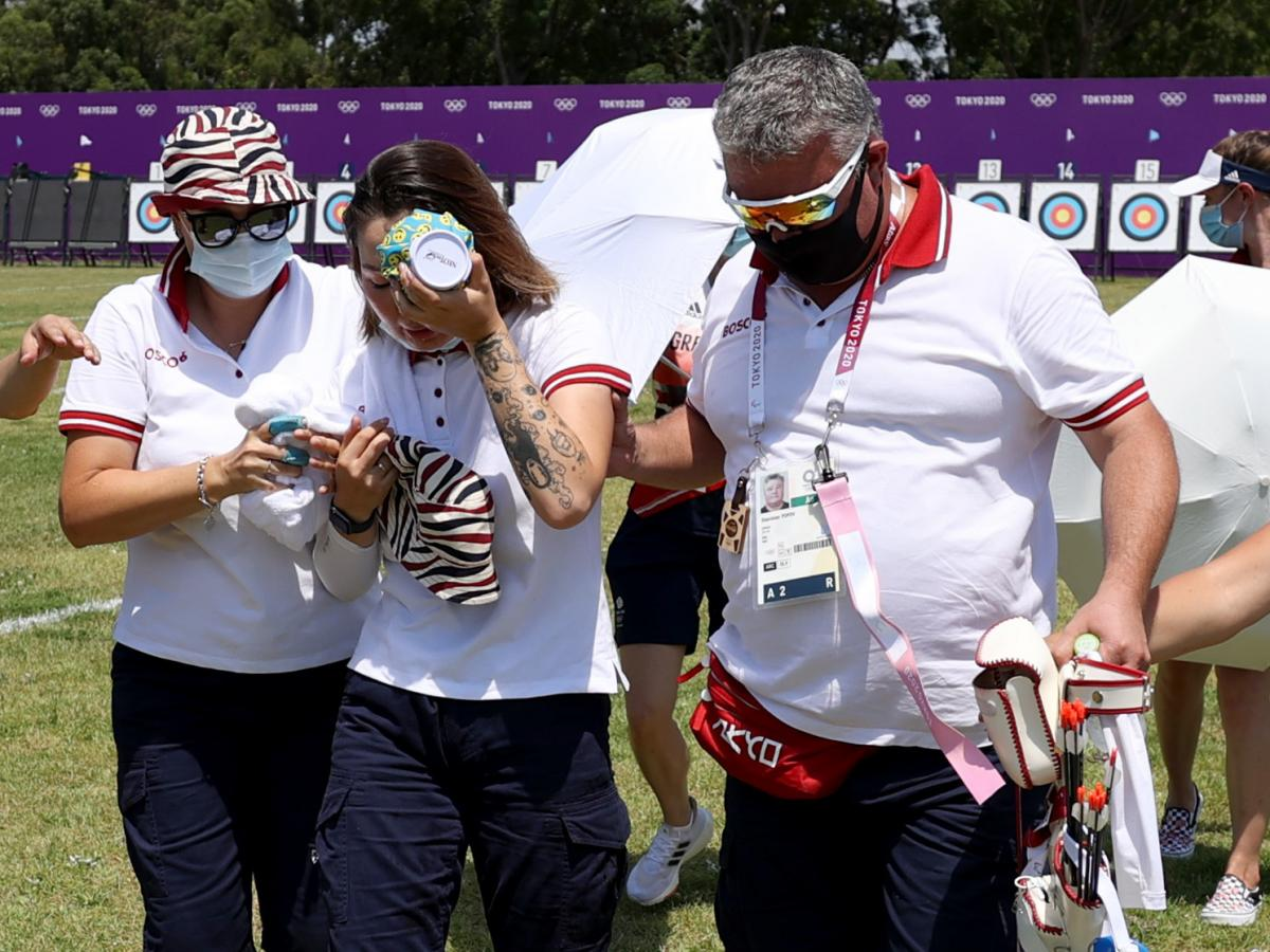 Svetlana Gomboeva is treated for heat exhaustion in the women's individual ranking round during the Summer Games at Yumenoshima Park Archery Field on Friday in Tokyo.