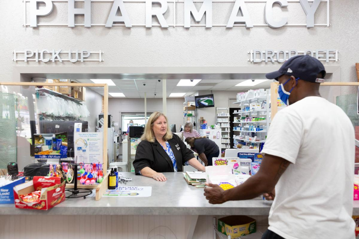 Pharmacist Cheryl Stimson checks in Michael Haynes, who came to the Dumas Family Pharmacy for his first vaccine shot on July 27. Stimson has given more than 5,800 vaccines since the start of the pandemic.