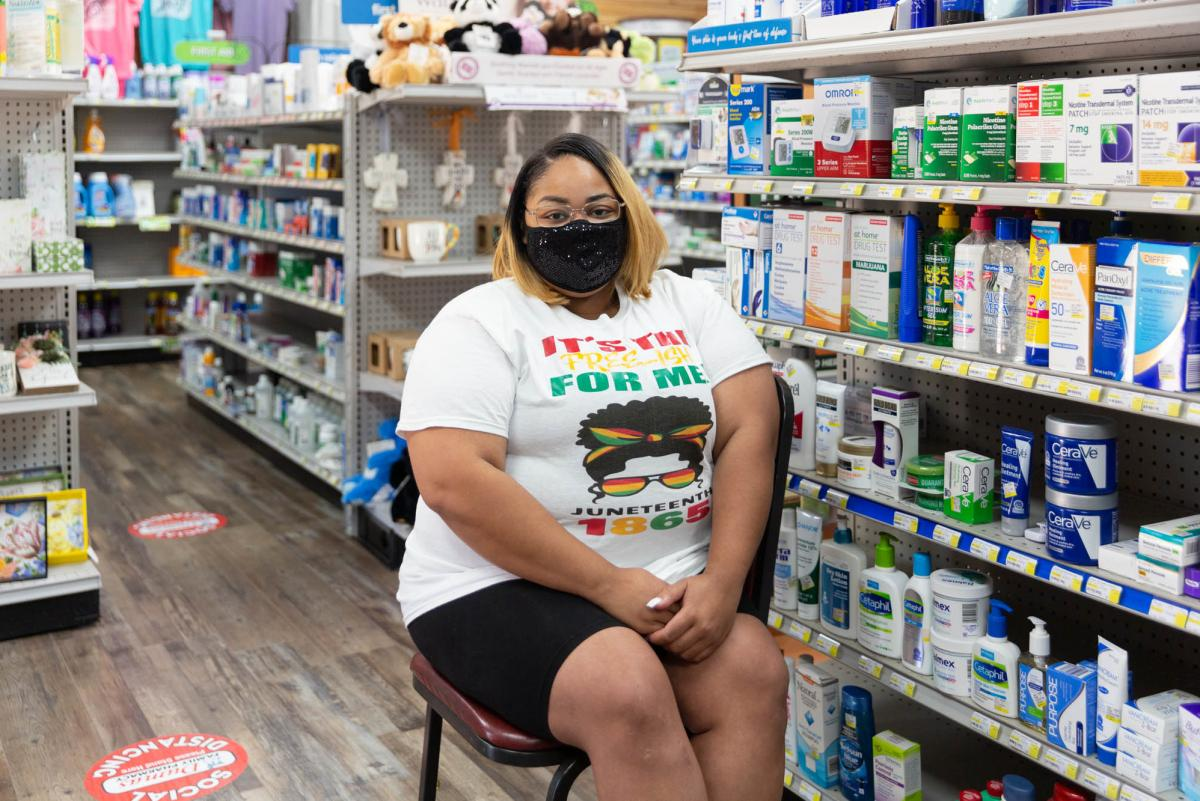 """Violet Mallett waits in the Dumas Family Pharmacy after receiving the vaccine. She had been worried about side effects and was relieved to feel fine after getting the shot. """"I'm OK. I'm not nervous anymore. I'm ready"""" for my second shot, she said."""