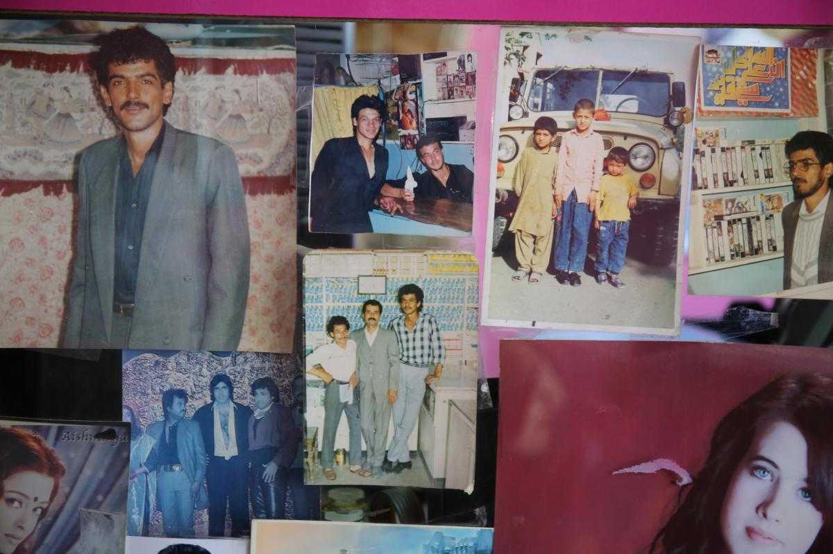 Unclaimed photographs decorate a small photo studio in the west of the capital.