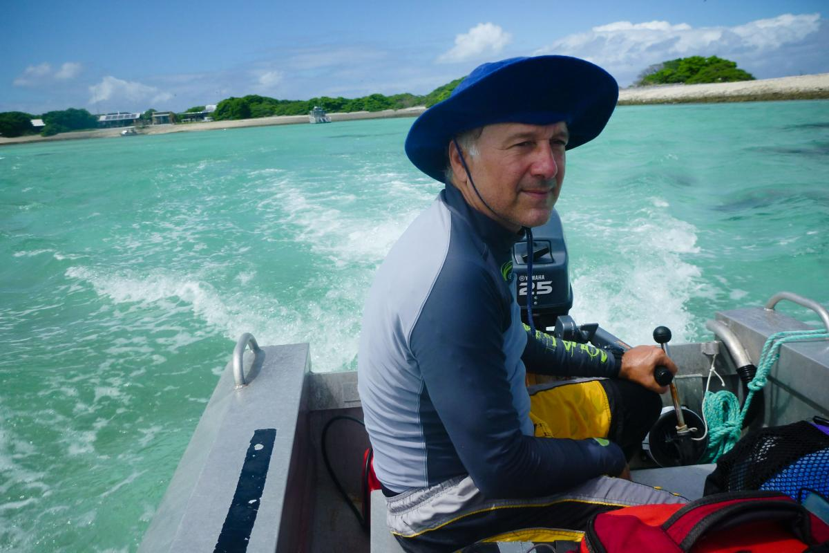 Ken Caldeira, a researcher with the Carnegie Institution for Science, pilots an aluminum skiff filled with equipment for his experiment on the reef. He is trying to figure out whether corals would grow faster if he neutralized human-induced changes in the