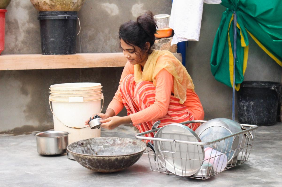 """Rana, here at her family's home, has been trying to study remotely, but she says her family loaded her with chores expected of a girl in her community. """"There's all kinds of housework I have to do,"""" she says."""