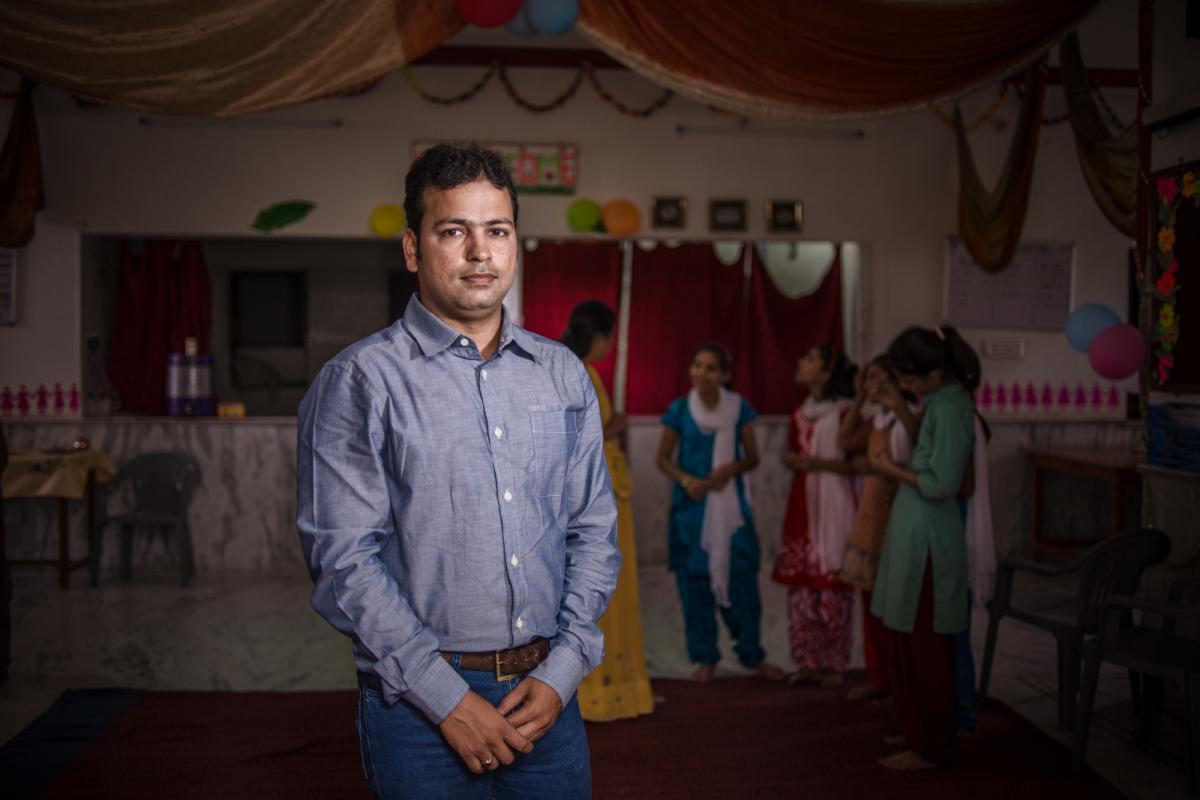 As a college student, Mahendra Sharma took on the challenge of convincing fathers to send their daughters to the Veerni Institute. He now serves as its director.