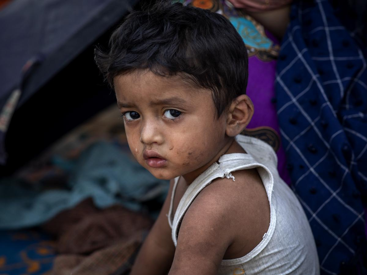 A Rohingya refugee boy shown after a massive fire broke out in March, destroying thousands of shelters and killing at least 15 people at Balukhali refugee camp in Cox's Bazar, Bangladesh.