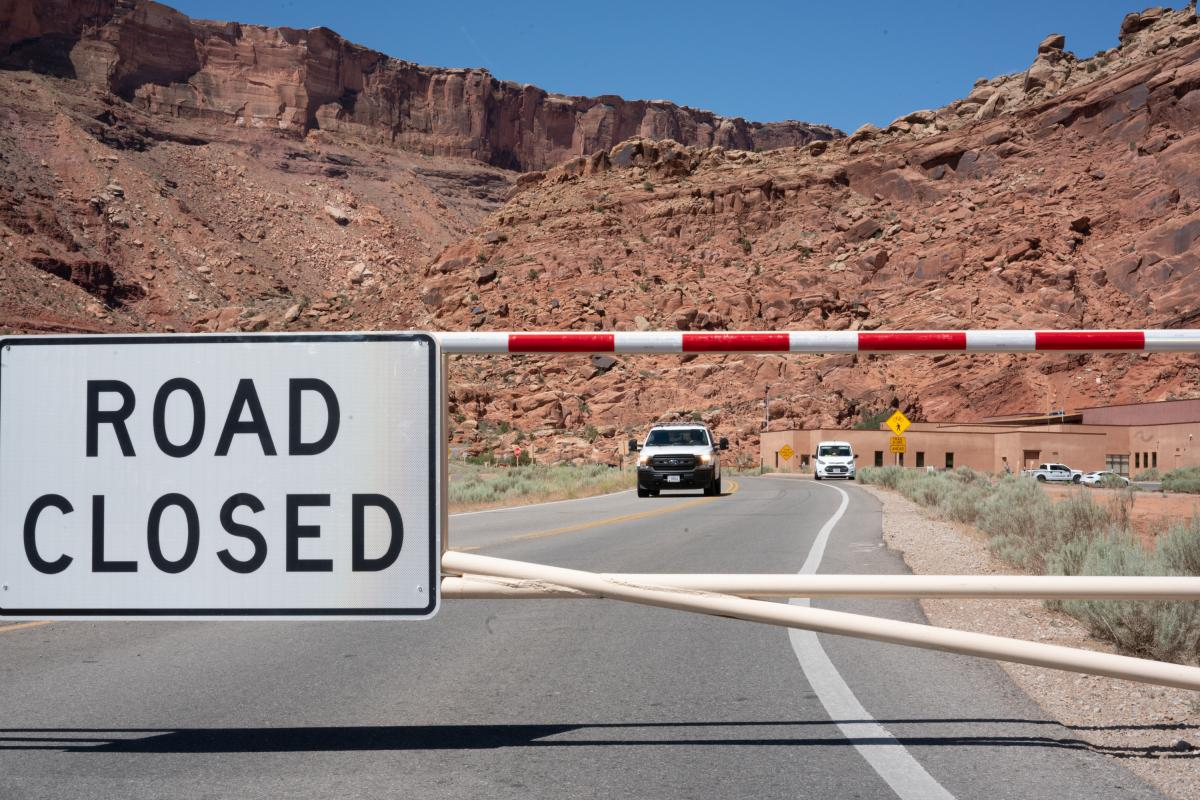 The gate to Arches National Park is closed on a weekday morning last month, as it is many mornings after the parking lots and trails quickly fill up.