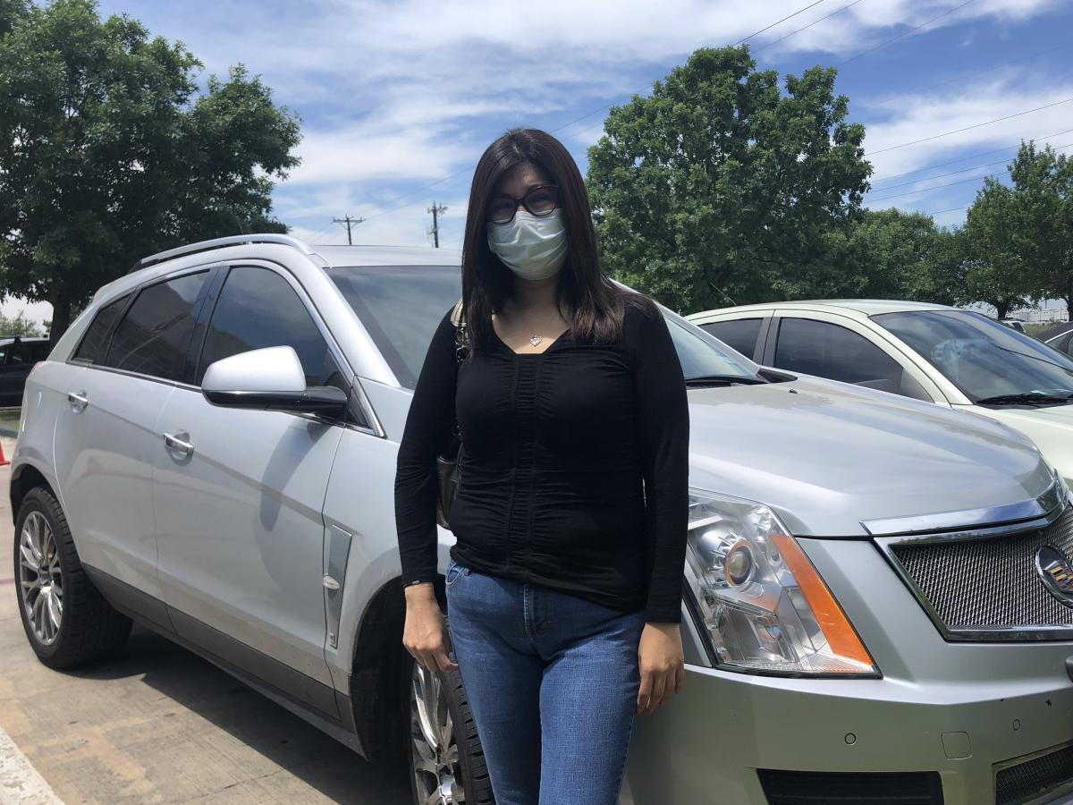 """Erica Campos says she initially felt ashamed driving up to the food bank in her used Cadillac, but """"there's no shame in feeding my children."""""""
