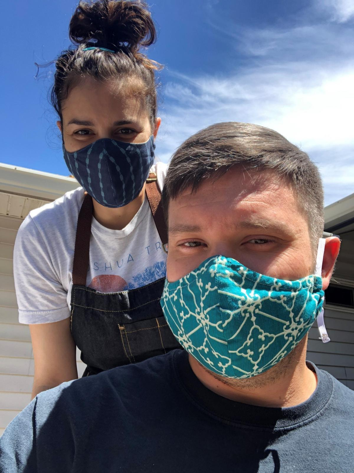 """Hairstylist Ashley Weiner cuts a friend's hair outdoors. She says she's worried about returning to work. She says that before the pandemic customers would often show up sick. """"They come and sit in my chair, and I often get sick and bring that home."""" She s"""