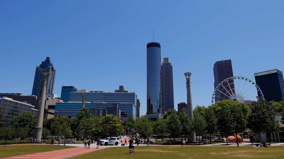 People visit Centennial Olympic Park in Atlanta on May 2. Many families in Atlanta and across the U.S. could face power disconnections as shut-off moratoriums imposed at the start of the pandemic expire. This comes as supplemental unemployment benefits ar