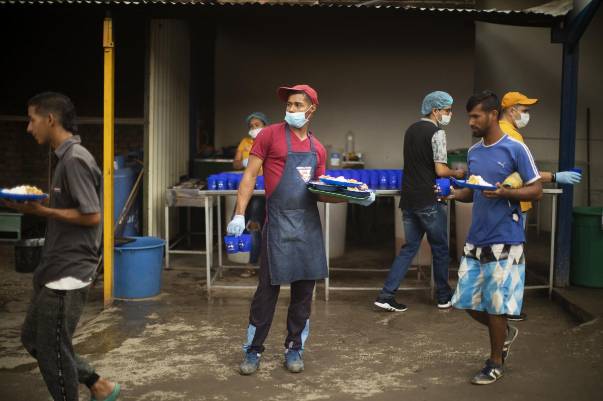 Alexis Rivero, 25, helps distribute meals at the kitchen.
