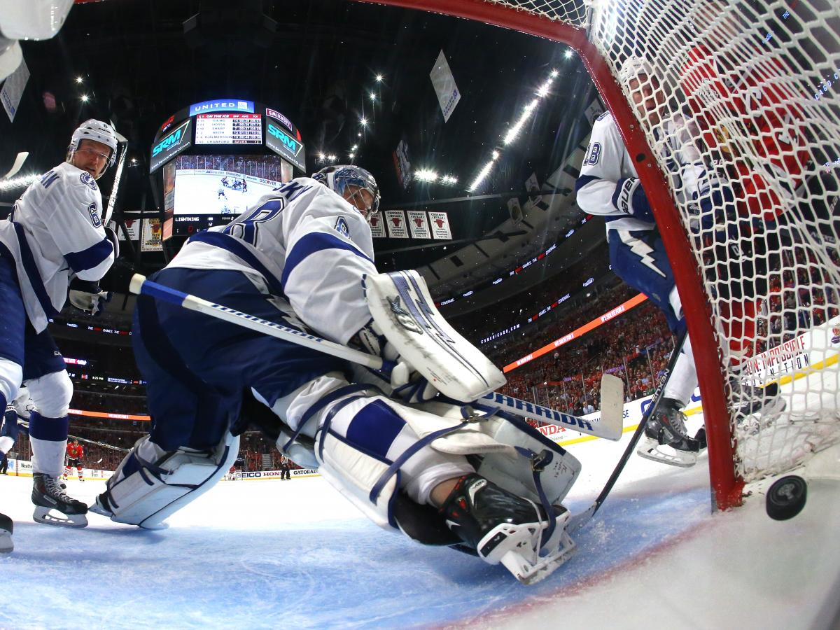 Anton Stralman, left, and Andrei Vasilevskiy of the Tampa Bay Lightning watch a shot by Jonathan Toews of the Chicago Blackhawks cross the line Wednesday night in the second period of Game Four of the Stanley Cup Finals in Chicago