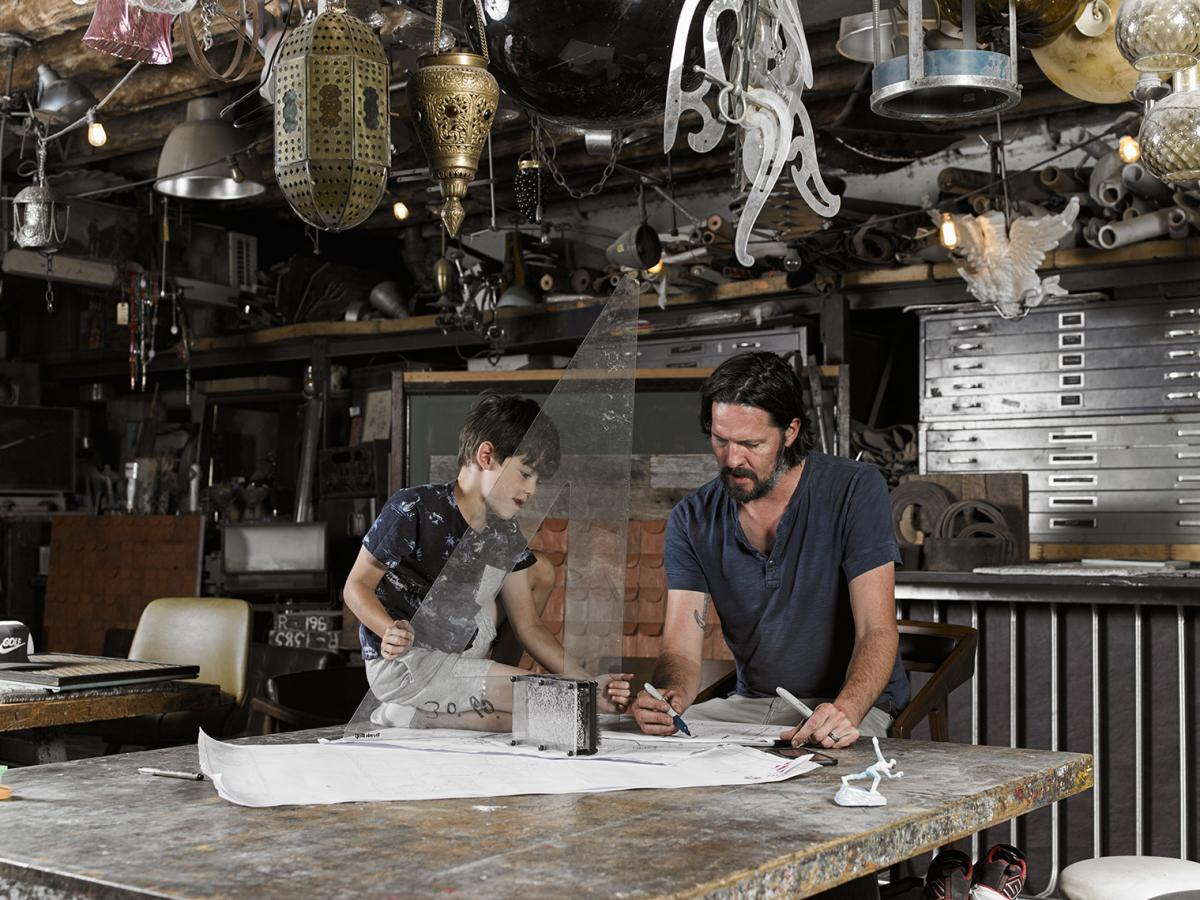 John designs bars and restaurants and has a big workshop. When Roman has days off from school, he often joins his dad at the shop. They live in Brooklyn.